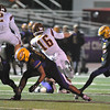 Jon Behm - The Morning Journal<br /> Avon Lake's Caleb Burr (16) gets around the block of Avon's Xavier Holmes (32) and blocks the kick attemp by Mitch Cooper (3) in the second quarter on Nov. 4.