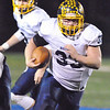 Jon Behm - The Morning Journal<br /> Olmsted Falls' Spencer Linville turns the corner for a big gain against Midview during the fourth quarter on Nov. 4.