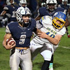 Randy Meyers - The Morning Journal<br /> Lorain running back Aaron Huff tries to turn the corner on Colton Doup of Olentangy during the first quarter of a Division I, Region 2 quarterfinal on Nov. 4.