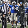 Jon Behm - The Morning Journal<br /> Midview Coach DJ Shaw questions a call by the official during the Middies game against Olmsted Falls on Nov. 4.