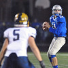 Jon Behm - The Morning Journal<br /> Midview's Dustin Crum looks down field for a receiver as Olmsted Falls' Luke Lombardo watches during the fourth quarter on Nov. 4.