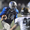 Jon Behm - The Morning Journal<br /> Midview's Dustin Crum looks for an opening into the end zone against Olmsted Falls during the third quarter on Nov. 4.