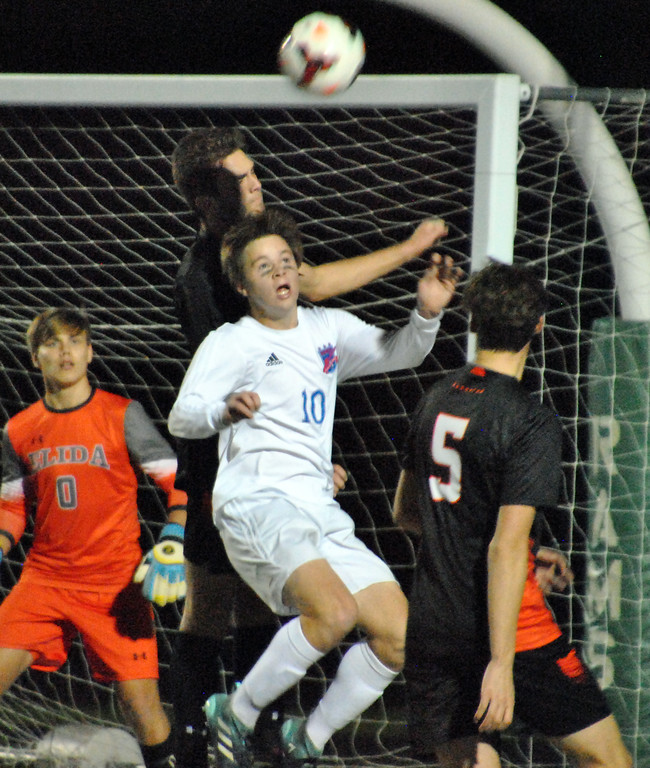 . Jon Behm - The Morning Journal<br> Bay sophomore Kyle Cusimano goes up for a contested header against Elida during the first half of the Division II, Region 6 final on Nov. 4.