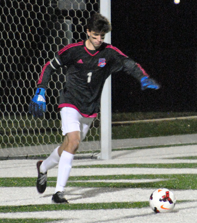 . Jon Behm - The Morning Journal<br> Bay goalkeeper Brent Hull puts the ball in play against Elida in the Division II, Region 6 final on Nov. 4.