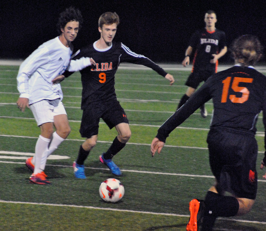 . Jon Behm - The Morning Journal<br> Bay sophomore Alex Eaton battles Elida\'s Sebastian Kunkleman for possession during the first half of the Division II, Region 6 final on Nov. 4.