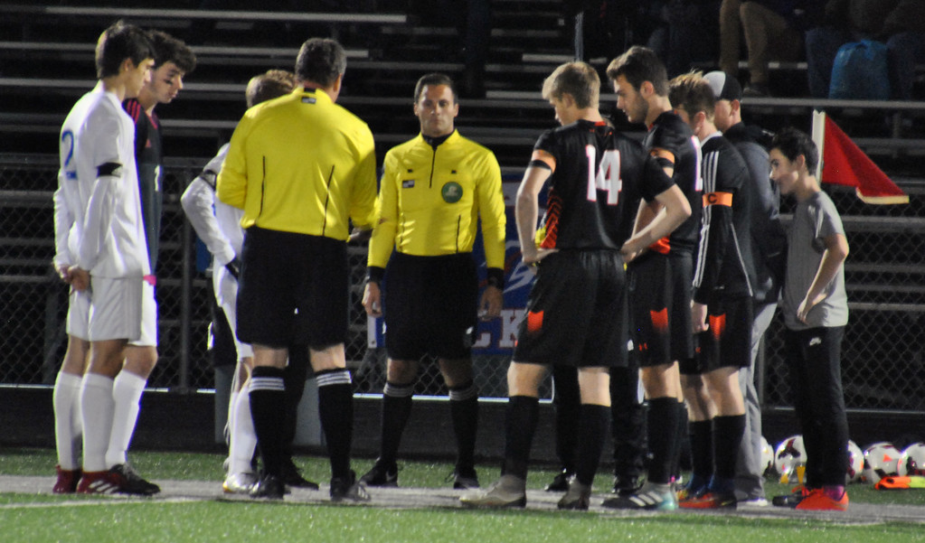 . Jon Behm - The Morning Journal<br> Captians from Bay and Elida speak with officials prior to the Division II, Region 6 final on Nov. 4.