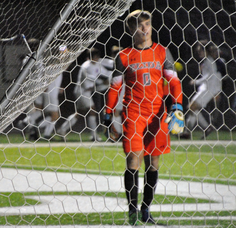 . Jon Behm - The Morning Journal<br> Elida goalkeeper Caleb Jones reacts after allowing a goal as Bay celebrates in the background on Nov. 4.