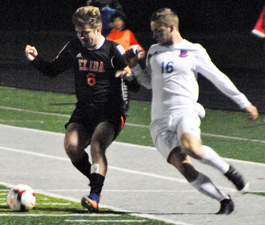 . Jon Behm - The Morning Journal<br> Bay senior Colin MacMillan battles with Elida\'s Cade Parker for the ball on Nov. 4.