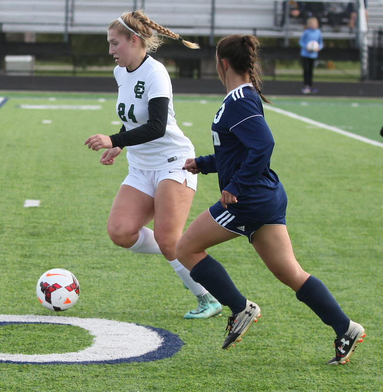 . Randy Meyers - The Morning Journal<br> Makenna Hodges of Elyria Catholic moves the ball past Katie McCollister of Kirtland during the first half on Saturday.