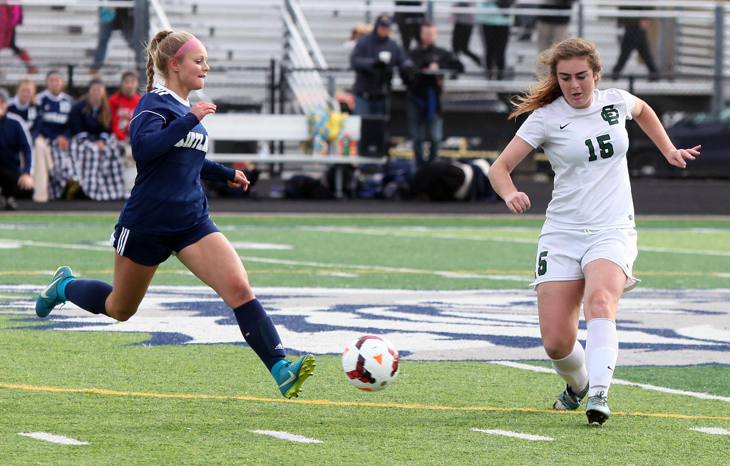. Randy Meyers - The Morning Journal<br> Emily Ungrady of Kirtland and Alexa  Oberg of Elyria Catholic converge on the ball near midfield during the  first half on Saturday.