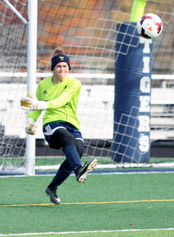 . Randy Meyers - The Morning Journal<br> Kirtland goal keeper Gabrielle Culotta kicks downfield against Elyria Catholic during the regional final on Saturday