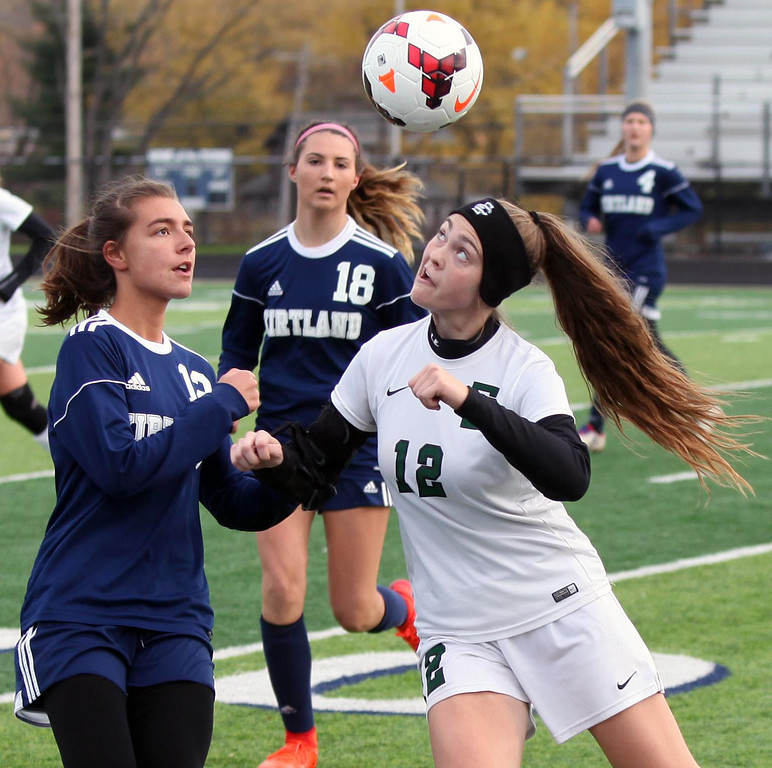 . Randy Meyers - The Morning Journal<br> Ryan Kunkle of Elyria Catholic heads the ball in front of Kirtland\'s Jessica Hepper during the first  half of the regional final on Saturday