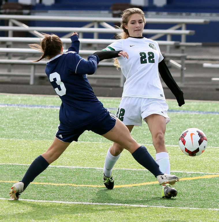 . Randy Meyers - The Morning Journal<br> Kirtland\'s Katie McCollister tries to block the kick by Elyria Catholic\'s Riley Doll during the regional final on Saturday.