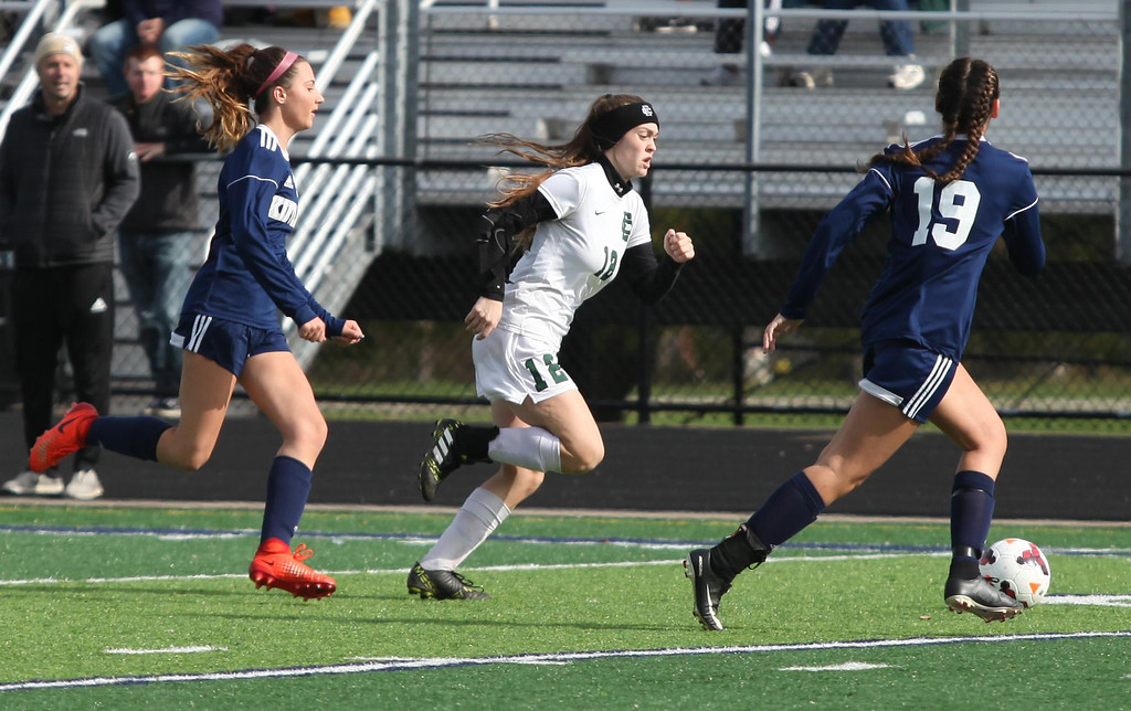 . Randy Meyers - The Morning Journal<br> Elyria Catholic\'s Ryan Kunkle moves  the ball past Tea Petric and Maggie Kadas of Kirtland during Saturday\'s  regional final