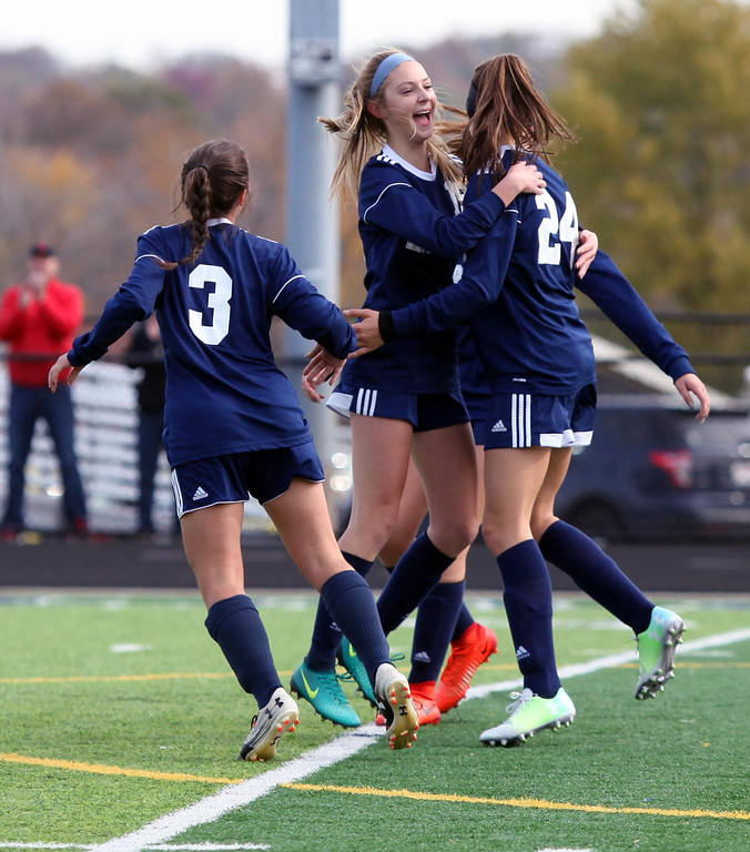. Randy Meyers - The Morning Journal<br> Kirtland celebrates after scoring their second against Elyria Catholic during the regional final on Saturday.