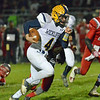 Paul DiCicco - The News-Herald<br /> Wickliffe Senior quarterback Lucas Thomeier gains yards up the middle against LaBrae on Nov. 5.
