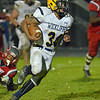 Paul DiCicco - The News-Herald<br /> Wickliffe sophomore running back Isaac Pettway runs around the right side against LaBrae on Nov. 5.