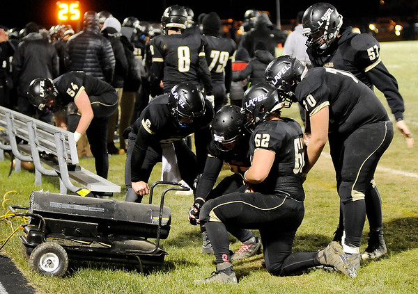 Don Knight    The Herald Bulletin<br /> Lapel players warm their hands as the Bulldogs hosted Eastbrook in Regional 18 on Friday.