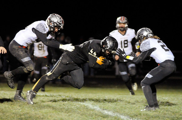 Don Knight    The Herald Bulletin<br /> Lapel's Dawson Phillips scores a touchdown as the Bulldogs hosted Eastbrook in Regional 18 on Friday.