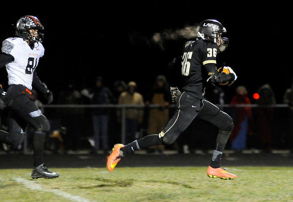 Don Knight |  The Herald Bulletin<br /> Lapel's Justin Engle runs after catching a pass from Levi Frazier as the Bulldogs hosted Eastbrook in Regional 18 on Friday.