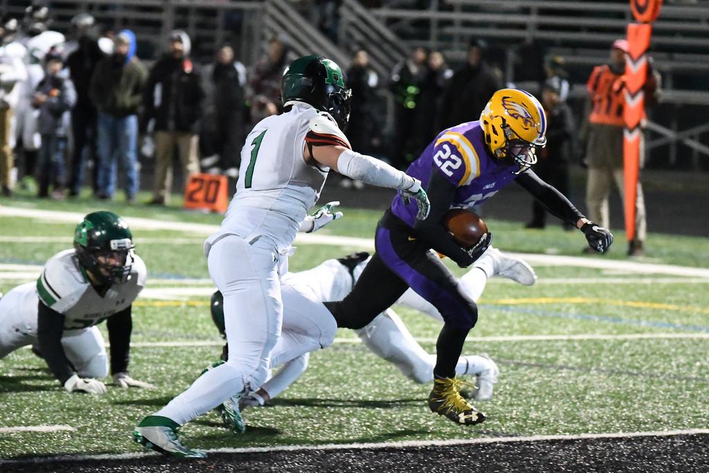 . Eric Bonzar�The Morning Journal<br> Avon\'s Nick Perusek (22) crosses the goal line for a touchdown.
