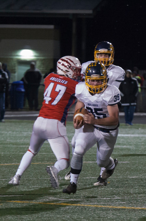 . Jen Forbus - The Morning Journal<br> Olmsted Falls\' Jack Spellacy makes his way around Wadsworth offensive linebacker Joey Fernholz on Nov. 10.