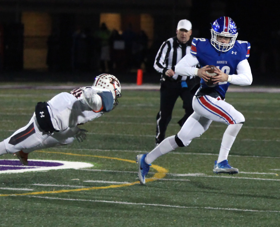 . Randy Meyers - The Morning Journal<br> Bay quarterback Connor Shell eludes the Padua pass rush as he gains a first down during the first quarter on Nov. 10.
