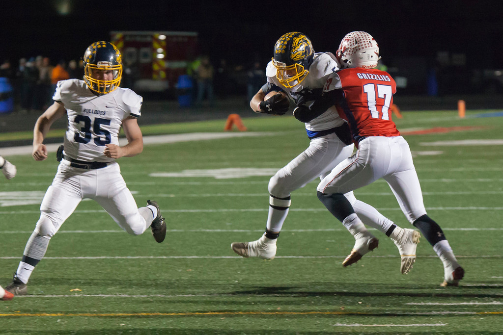 . Jen Forbus - The Morning Journal<br> Olmsted Falls\' Luke Lombardo tries to break away from Wadsworth middle linebacker Mason McMillen on Nov. 10.