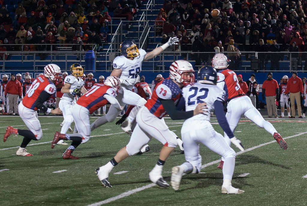 . Jen Forbus - The Morning Journal<br> Olmsted Falls defensive lineman John McCabe makes a long stretch to try to block a pass by Wadsworth quarterback Joey Baughman.