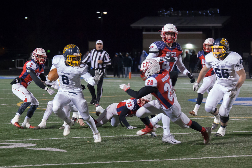 . Jen Forbus - The Morning Journal<br> Olmsted Falls wide receiver Michael Howard fends off Wadsworth\'s Noah Alic on Nov. 10.