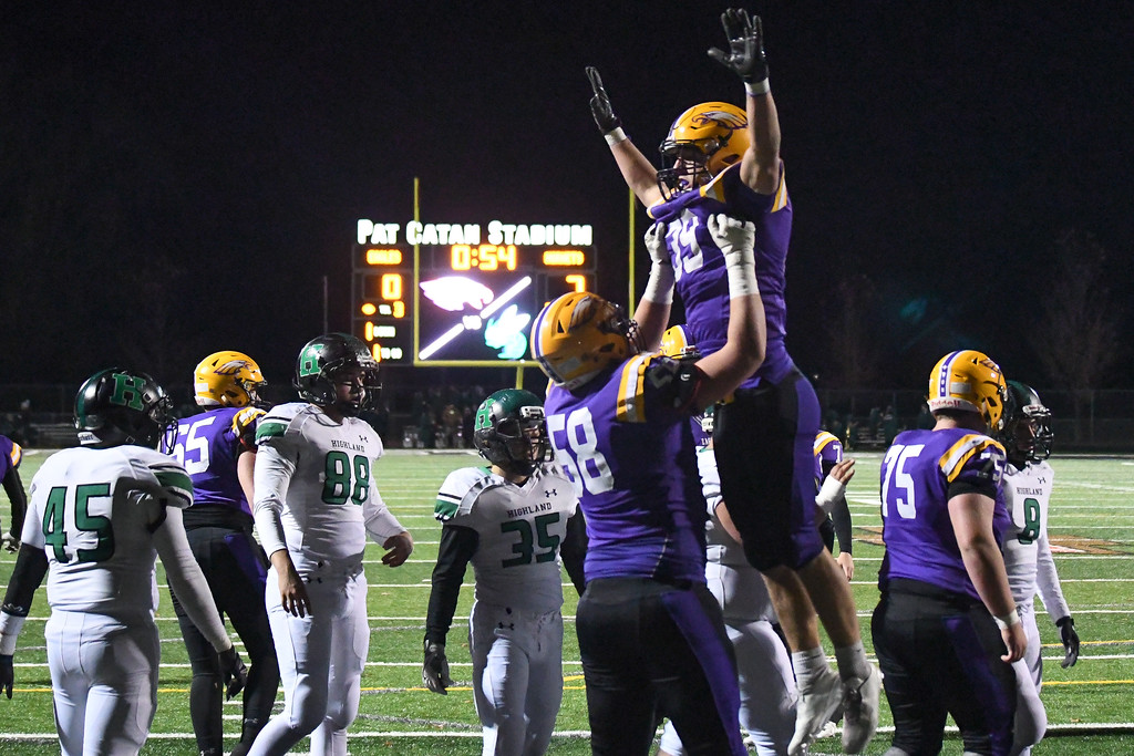 . Eric Bonzar�The Morning Journal<br> Avon\'s Mark Steinmetz (39) is hoisted in the air by his linebacker Jimmy McKenna (58) after Steinmetz scores from one yard out.