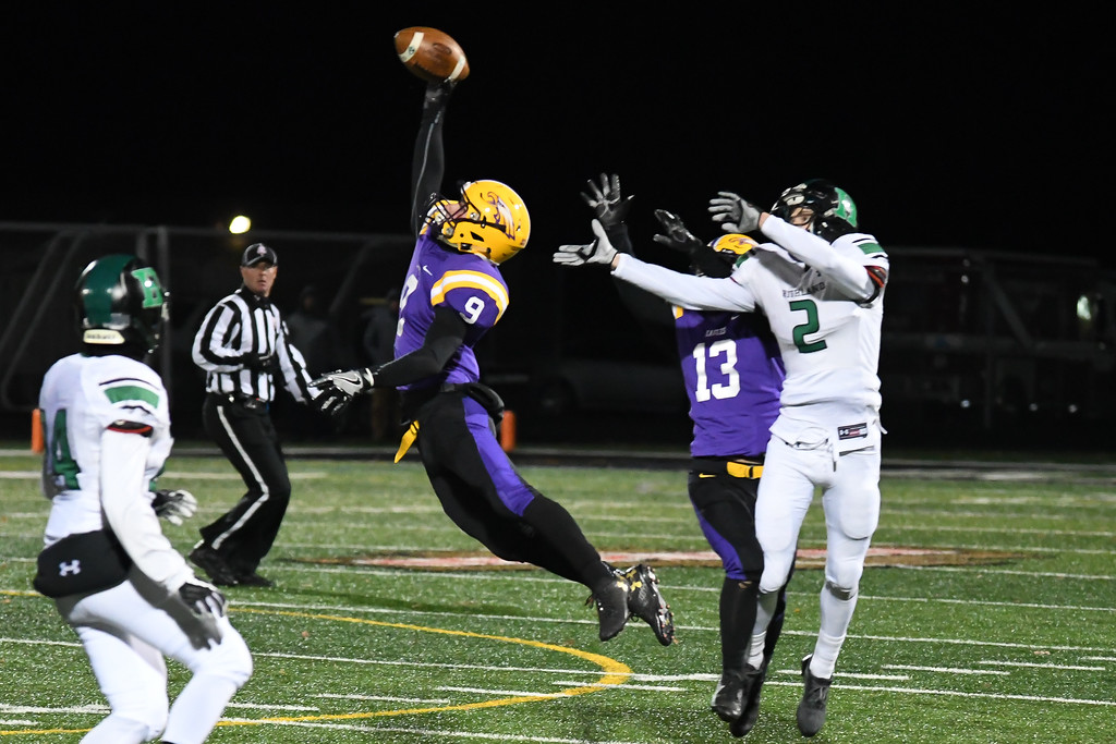 . Eric Bonzar�The Morning Journal<br> Avon\'s David Orlando (9) goes up and snags a one-handed interception meant for Medina Highland wide receiver Jake Sir Louis (2).