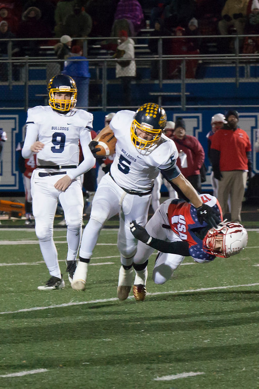 . Jen Forbus - The Morning Journal<br> Olmsted Falls wide receiver Luke Lombardo breaks away from Wadsworth middle linebacker Mason Mcmillen to gain yardage on Nov. 10.