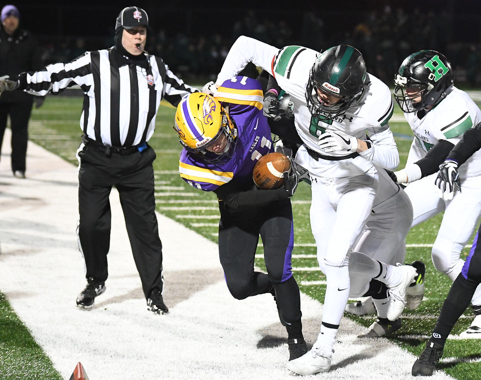 . Eric Bonzar�The Morning Journal<br> Avon\'s Chris Mullins (11) is pushed out of bounds by Medina Highland\'s Jake Tecco (6).