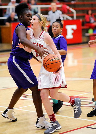 Don Knight |  The Herald Bulletin<br /> Frankton's Ava Gardner draws a foul from Muncie Central's Tonisha Lowe on a drive to the basket on Saturday.