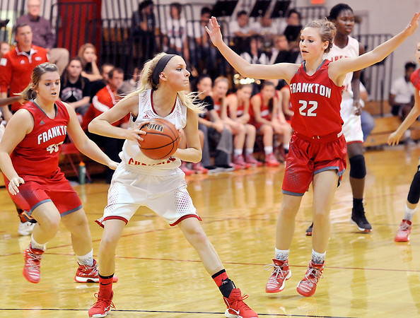 John P. Cleary |  The Herald Bulletin<br /> Frankton's Maddie Rastetter, 40, and Sierra Southard, 22, put pressure defense on Liberty Christian's Savanah Rees, 30, as she tries to bring the ball up court.