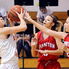 John P. Cleary |  The Herald Bulletin<br /> Liberty Christian's Savannah Rees tries to get a shot off as Frankton's Addie Gardner and Sierra Southard come in to defend.