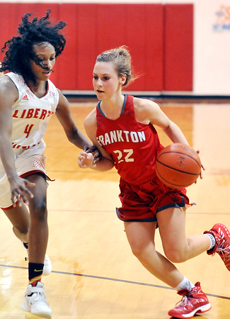 John P. Cleary |  The Herald Bulletin<br /> Frankton's Sierra Southard drives into the lane as Liberty Christian's Monica Watkins tries to defend her.