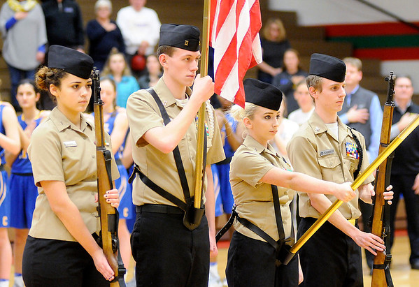 Don Knight | The Herald Bulletin<br /> Students in Anderson's NJROTC program present the colors before the Lady Tribe's game against Carmel on Wednesday.