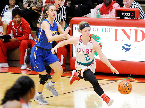 Don Knight   The Herald Bulletin<br /> Anderson's Katie Martin brings the ball down court for the Lady Tribe as they hosted Carmel on Wednesday.