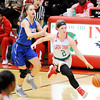 Don Knight | The Herald Bulletin<br /> Anderson's Katie Martin brings the ball down court for the Lady Tribe as they hosted Carmel on Wednesday.