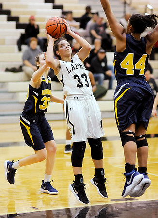 Don Knight |  The Herald Bulletin<br /> Lapel's Delany Peoples shoots on a baseline drive as she is guarded by Shenandoah's Erikka Hill on Thursday.
