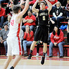 Don Knight | The Herald Bulletin<br /> Madison-Grant's Kaden Howell shoots as he is guarded by Frankton's Rylan Detling on Friday.