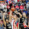 Don Knight | The Herald Bulletin<br /> Frankton's Jon Hatzell drives to the basket between Madison-Grant's Isaac Cooper and Grant Brown on Friday.