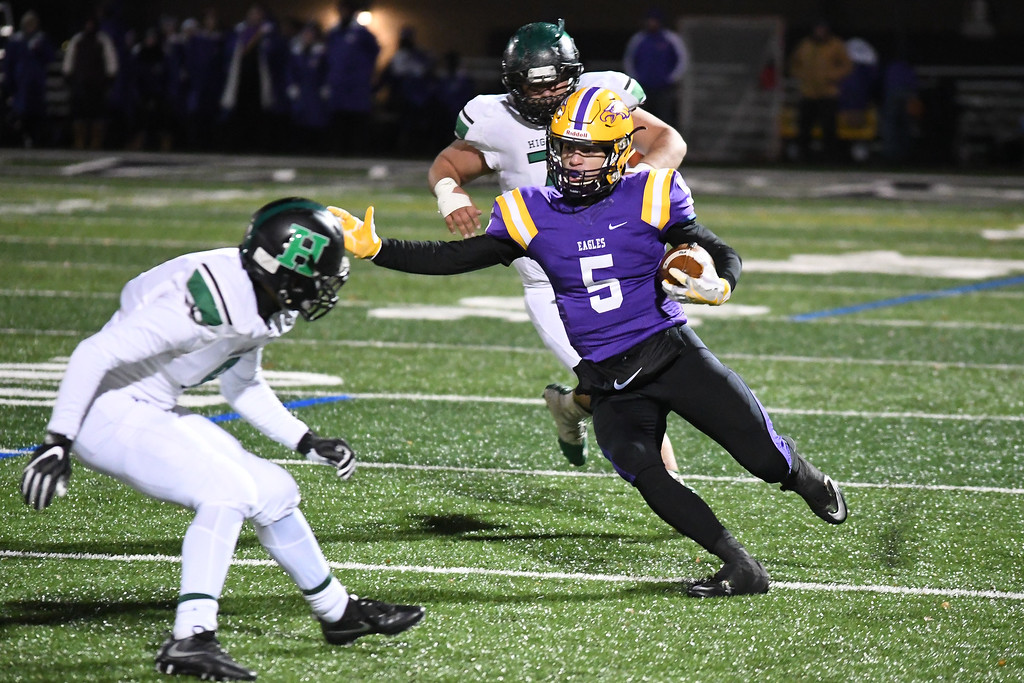 . Eric Bonzar�The Morning Journal<br> Avon quarterback Ryan Maloy (5) cuts up the field through the Medina Highland defense.