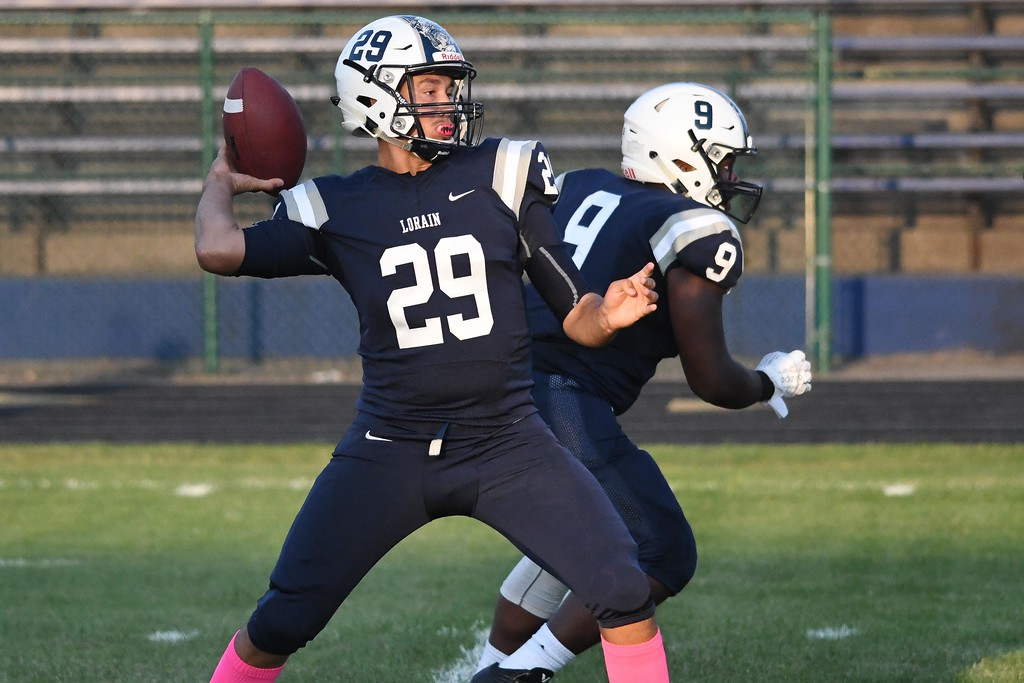 . Eric Bonzar�The Morning Journal<br> Lorain quarterback Justin Sturgill (29) drops back for a pass, Aug. 25, 2017.