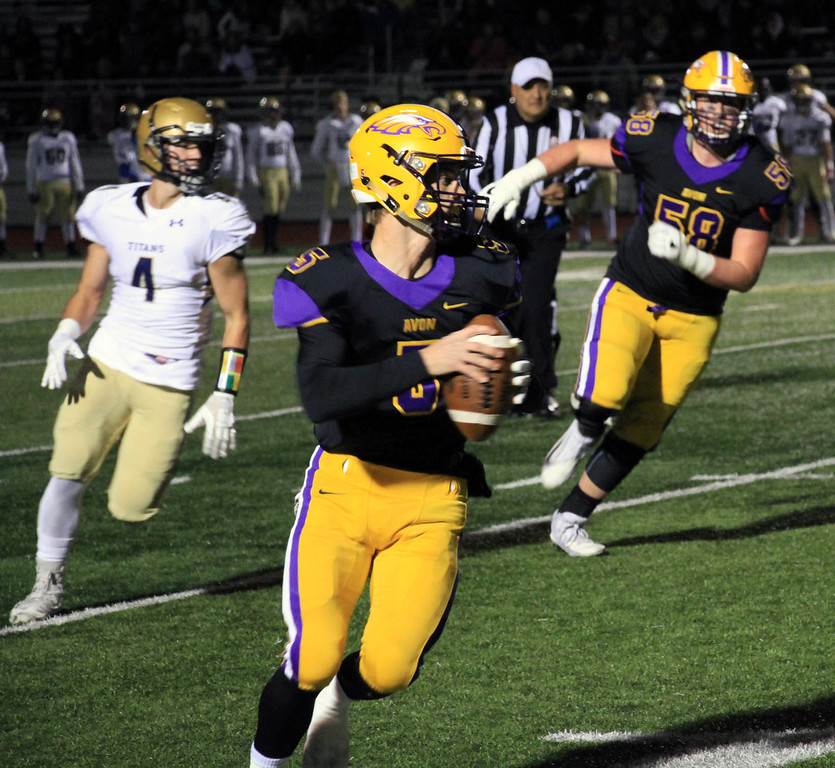 . Nicholas Pfeifer - The Morning Journal<br> Avon quarterback Ryan Maloy scrambles out of the pocket and runs for a big gain against St. John\'s Jesuit on Nov. 3.