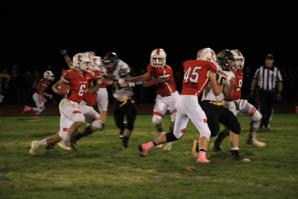 . Nicholas Pfeifer - The Morning Journal<br> Firelands\' Nick Denney comes in motion and takes the hand off for a big gain around the right edge against Black River on Oct. 20.