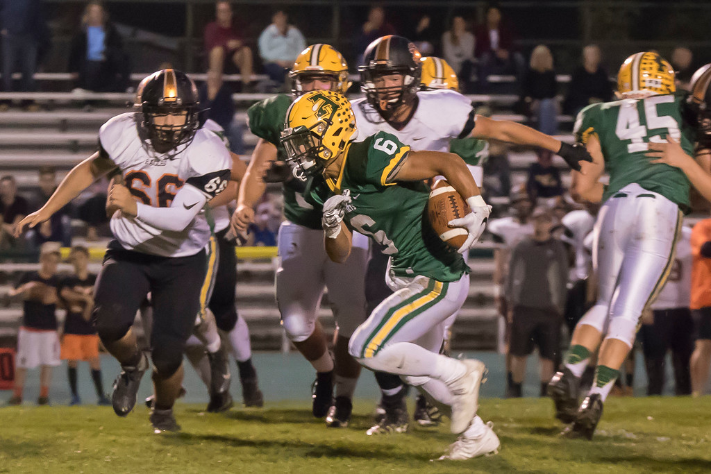 . Jen Forbus - The Morning Journal<br> Amherst running back Khennedy Scagliozzo gains yards as the North Olmsted defense closes in on him on Oct. 13.