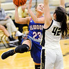 Don Knight | The Herald Bulletin<br /> Elwood's Sherrie Taylor shoots as she is guarded by Lapel's Ashlynn Allman on Tuesday.